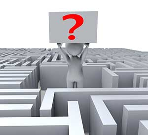 Man in a maze holding a question mark